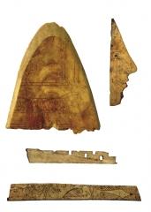 Фрагменты резного декора деревянного саркофага из основного погребения. Слоновая кость.